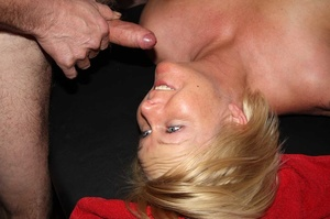 Tattooed blonde sucks a huge dick then takes off her flesh shirt and lets a group of guys fuck her while she sucks their cocks til she gets creamed on a black bed. - XXXonXXX - Pic 14