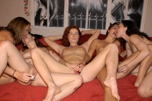 A group of hot girls making out while stripping their sexy shirts and skirts then they lick each others tits, ass and pussies before they nail each others cracks with hard toys on a red couch. - XXXonXXX - Pic 12