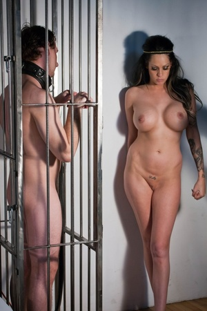 Busty tattooed beauty torturing encaged man while another one riding a dick - XXXonXXX - Pic 1