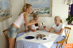 Two luscious blondes wearing white shirts and jeans skirts lick the tits of another hot blonde wearing white tube with pink polka dots and jeans skirt before they all get naked and drill each others pussies with different toys while they lick them on a dining table. - XXXonXXX - Pic 1