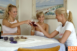 Two luscious blondes wearing white shirts and jeans skirts lick the tits of another hot blonde wearing white tube with pink polka dots and jeans skirt before they all get naked and drill each others pussies with different toys while they lick them on a dining table. - XXXonXXX - Pic 3