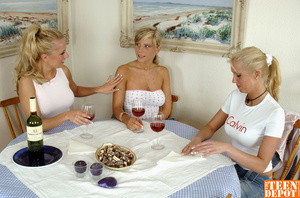 Two luscious blondes wearing white shirts and jeans skirts lick the tits of another hot blonde wearing white tube with pink polka dots and jeans skirt before they all get naked and drill each others pussies with different toys while they lick them on a dining table. - XXXonXXX - Pic 6