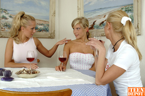 Two luscious blondes wearing white shirts and jeans skirts lick the tits of another hot blonde wearing white tube with pink polka dots and jeans skirt before they all get naked and drill each others pussies with different toys while they lick them on a dining table. - XXXonXXX - Pic 7