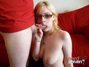 Cute, topless blonde with glasses gets busy slurping cock in front of a red couch. - XXXonXXX - Pic 10