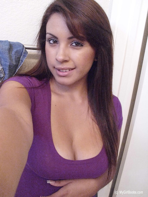 Big-breasted brunette pulls up purple top in a series of scintillating selfies. - XXXonXXX - Pic 1