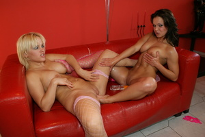 Sexy blonde and a gorgeous babe wearing pink fishnet stockings lick and suck each others big boobs on a red leather couch before they nail their whole fists in each others ass and pussies. - XXXonXXX - Pic 18