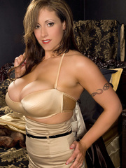 Busty chick takes off her gold blouse and skirt then - Picture 3