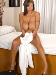 Busty mom takes off her white robe and pose her luscious - Picture 15