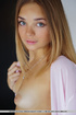 Tantalizing teen removes her sheer pink robe…