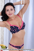 Cute bra and panty set embellished with hearts is tossed on a brunettes