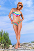 Intriguing teen strips on rocky terrain in a red-hot outdoor display of