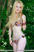 Fair-skinned blonde hidden in the brush sheds her bikini to show off a