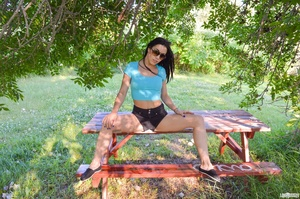 First-rate chica in a blue midriff shirt and black shorts flashing her boobs under a tree. - XXXonXXX - Pic 3