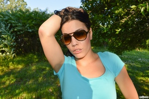 First-rate chica in a blue midriff shirt and black shorts flashing her boobs under a tree. - XXXonXXX - Pic 9