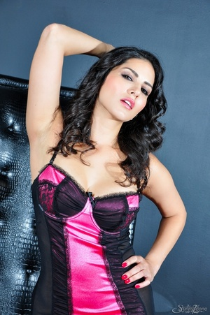 Alluring dame in a black and pink nightie parts her nether lips on a black chair. - XXXonXXX - Pic 1