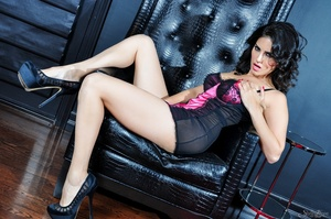 Alluring dame in a black and pink nightie parts her nether lips on a black chair. - XXXonXXX - Pic 10
