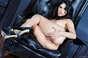 Alluring dame in a black and pink nightie parts her nether lips on a black chair. - XXXonXXX - Pic 15