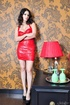 Exceptional vamp in a red dress gets naked near a…