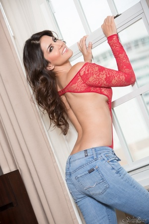 Superb babe in a red teddy and jeans flashes her privates by the window. - XXXonXXX - Pic 2
