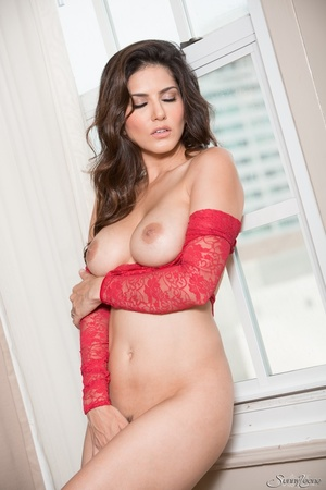 Superb babe in a red teddy and jeans flashes her privates by the window. - XXXonXXX - Pic 14