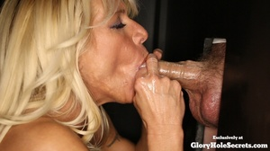 Blonde cougar munching stranger's dicks at the holes of black walls and suck their sperms before she lets one squeeze her huge boobs while the other fingers her pussy. - XXXonXXX - Pic 4
