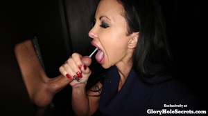 Tattooed chick is on her knees spraying spunk in her mouth as she jerks off a huge dick at a glory hole then she takes off her violet blouse and displays her huge boobs before sucks another dick at a different hole and eats its cum. - XXXonXXX - Pic 2