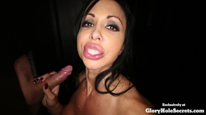 Tattooed chick is on her knees spraying spunk in her mouth as she jerks off a huge dick at a glory hole then she takes off her violet blouse and displays her huge boobs before sucks another dick at a different hole and eats its cum. - XXXonXXX - Pic 12