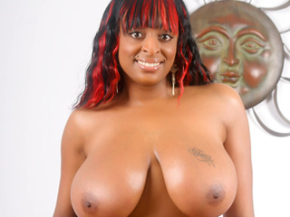 Ebony hottie with massive titties pleasing herself with - Picture 1