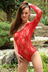Hot brunette teen in a red lace body having fun with a pussy stretcher