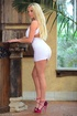 Sexy blonde in short hot white dress takes it off to show body and finger