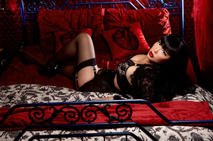 Luscious Asian babe displays her erotic body in all black lingerie, nighty, stockings with suspenders and high heels then she takes off her bra and expose her big round boobs before she removes her panty and bares her sexy booty while she lays down seductively on a red, white and gray bed. - XXXonXXX - Pic 2