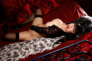 Luscious Asian babe displays her erotic body in all black lingerie, nighty, stockings with suspenders and high heels then she takes off her bra and expose her big round boobs before she removes her panty and bares her sexy booty while she lays down seductively on a red, white and gray bed. - XXXonXXX - Pic 15