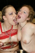 Ponytailed inked bitch in red fishnet and her BFF…
