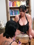 Fat and hot babes wearing black corsets joined by a lesbian redhead wearing