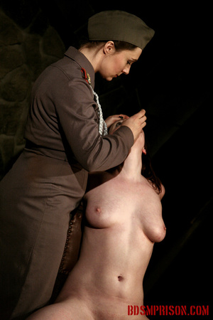 Guards in uniform feeding a dildo to a naked prisoner in the interrogation room. - XXXonXXX - Pic 1