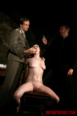 Guards in uniform feeding a dildo to a naked prisoner in the interrogation room. - XXXonXXX - Pic 4