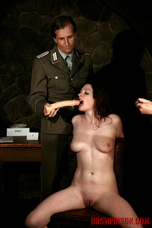 Guards in uniform feeding a dildo to a naked prisoner in the interrogation room. - XXXonXXX - Pic 5