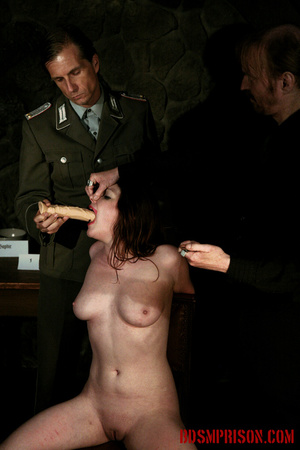 Guards in uniform feeding a dildo to a naked prisoner in the interrogation room. - XXXonXXX - Pic 7