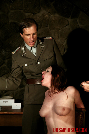 Guards in uniform feeding a dildo to a naked prisoner in the interrogation room. - XXXonXXX - Pic 8