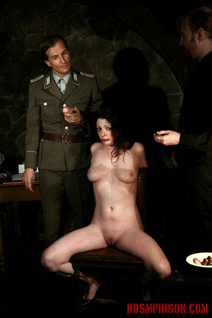 Guards in uniform feeding a dildo to a naked prisoner in the interrogation room. - XXXonXXX - Pic 10