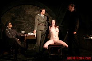 Guards in uniform feeding a dildo to a naked prisoner in the interrogation room. - XXXonXXX - Pic 11