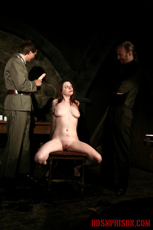 Guards in uniform feeding a dildo to a naked prisoner in the interrogation room. - XXXonXXX - Pic 12