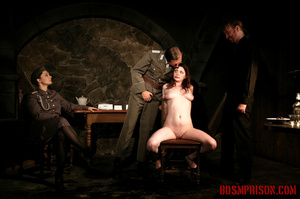 Guards in uniform feeding a dildo to a naked prisoner in the interrogation room. - XXXonXXX - Pic 13