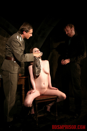 Guards in uniform feeding a dildo to a naked prisoner in the interrogation room. - XXXonXXX - Pic 15