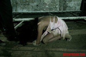 Brunette prisoner in a tattered pink dress gets whipped with a riding crop in her cell. - XXXonXXX - Pic 3