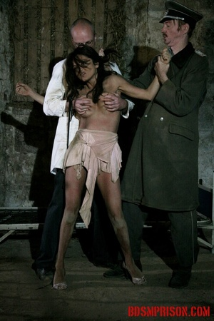 Brunette prisoner in a tattered pink dress gets whipped with a riding crop in her cell. - XXXonXXX - Pic 10