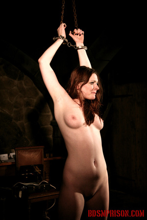 Chained naked girl gets tortured and pisses at the dungeon. - XXXonXXX - Pic 1