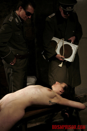 Slim broad in the nude gets the hot and cold treatment from her interrogators. - XXXonXXX - Pic 1