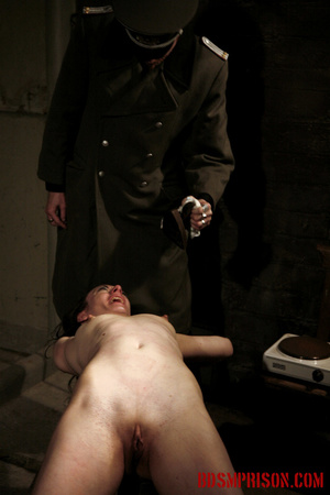 Slim broad in the nude gets the hot and cold treatment from her interrogators. - XXXonXXX - Pic 3