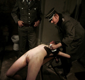 Slim broad in the nude gets the hot and cold treatment from her interrogators.
